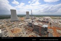The cooling towers for Plant Vogtle reactors 3 and 4 rise above the construction sites. GEORGIA POWER